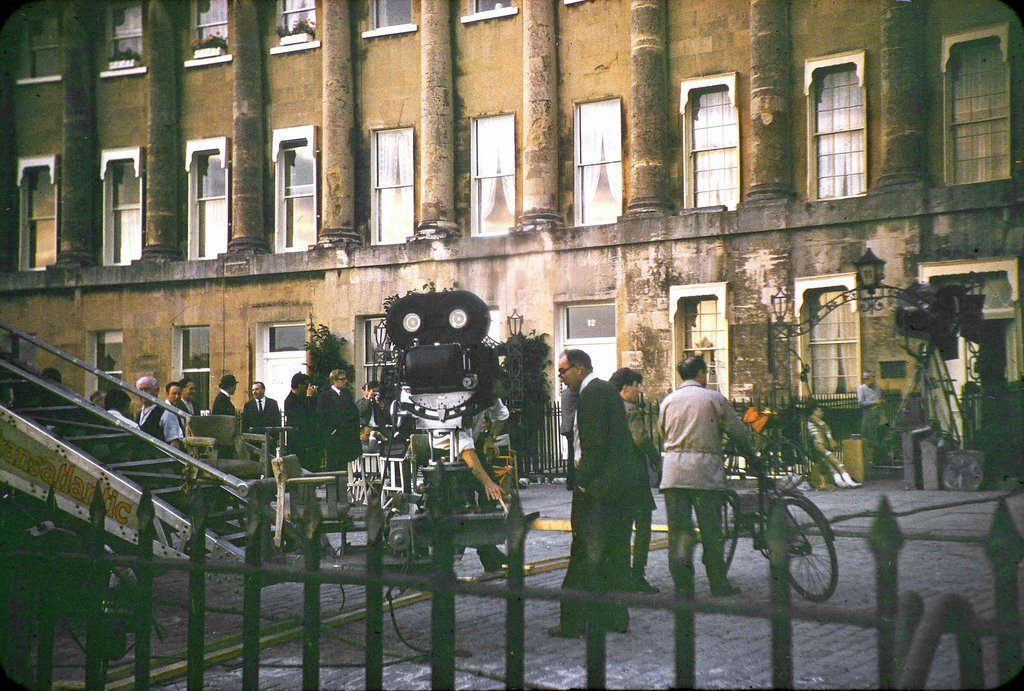 The film crew, film camera and crane together with others 'on set' during the filming of The Wrong Box against part of the Royal Crescent, Bath.