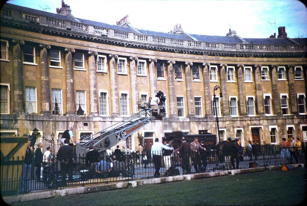 The film crew, film camera and crane together with others 'on set' during the filming of The Wrong Box against part of the Royal Crescent, Bath. As viewed from the green.