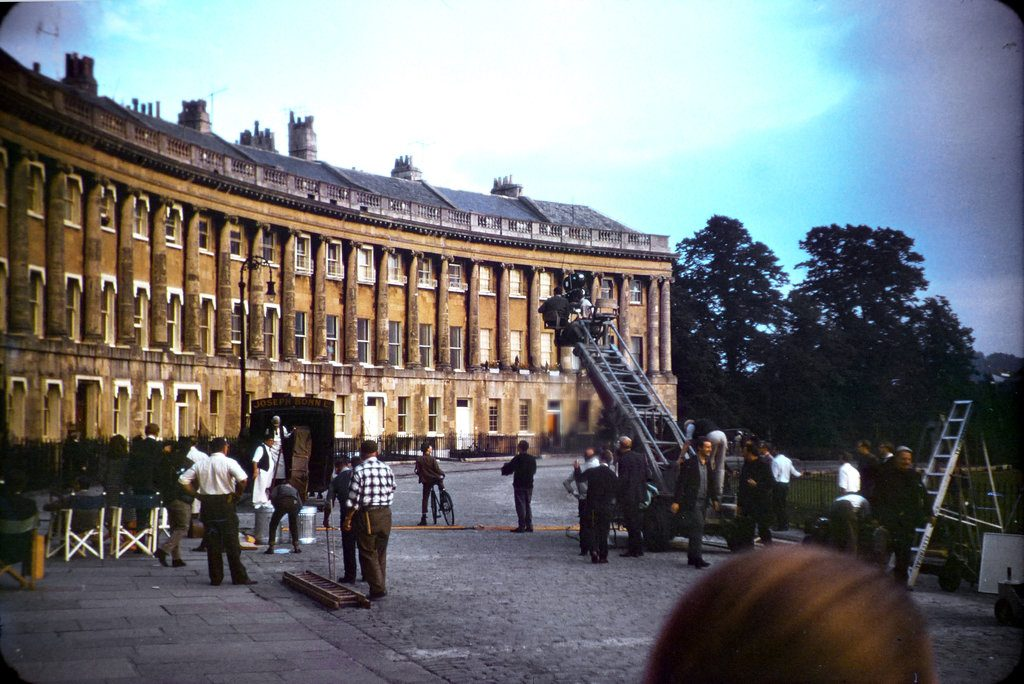 A wide angle shot of the film crew, film camera and crane together with others 'on set' during the filming of The Wrong Box against part of the Royal Crescent, Bath. Filmed from the right hand side. Filmed from the left hand side.