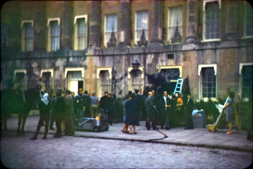 The film crew with others 'on set' during the filming of The Wrong Box against part of the Royal Crescent, Bath.